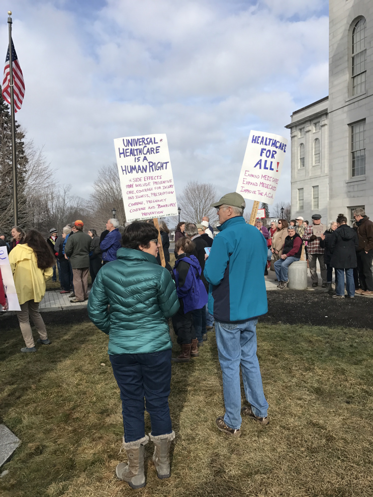 An estimated 200 people rallied near the State House in Augusta in support of the Affordable Care Act, also known as Obamacare, in February.