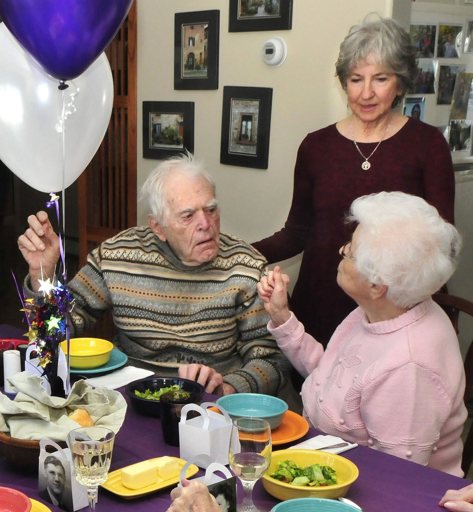 Party host Toni Ramundo speaks with two of the six members of the Waterville High School graduating class of 1942 who celebrated a reunion at Ramundo's home in Winslow on Monday. Classmates Burns Hillman and Dorothy Doucette chat about the old days during the party.