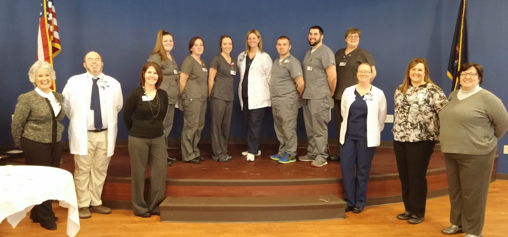 In front, from left, are Development instructor Kathleen Lewia, Classroom Instructor Chris Miller, R.N., Administrator Shannon Lockwood, Clinical Instructor Desiree Knowles R. N., Administrator Megan Stiles and Public Relations/Marketing Director Tami Thibodeau. In back, from left, are Chelsea George, Courtney Fraser, Alexandria Hansen, Director of Nursing Patty Shuck R.N., Zachary Fontana-Howe, Darren Gilbert and Gloria Weeks.