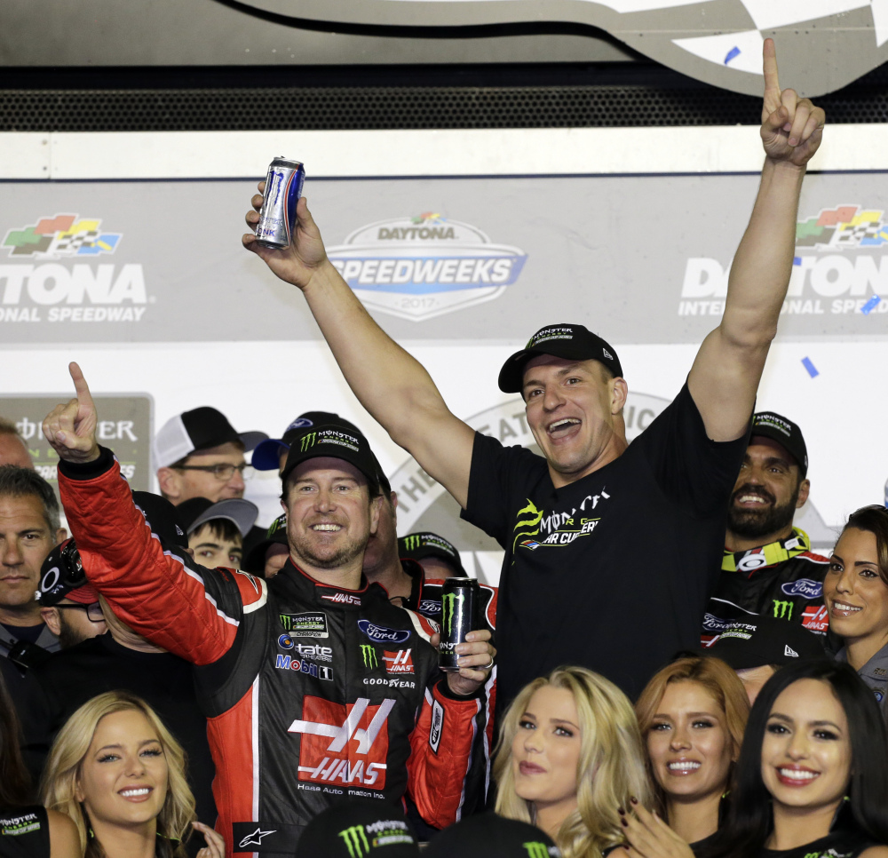 Kurt Busch, left, celebrates in Victory Lane with New England Patriots tight end Rob Gronkowski after winning the Daytona 500 at Daytona International Speedway on Sunday.