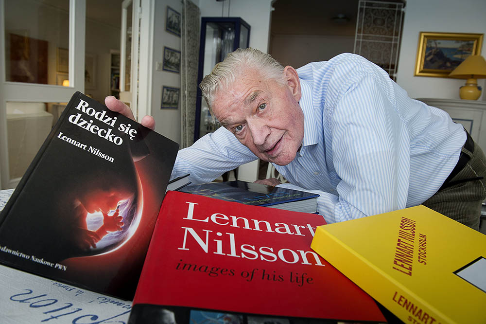 Photographer Lennart Nilsson poses with some of his books in 2012.  Nilsson died Saturday.
