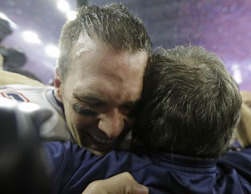 Tom Brady celebrates with Coach Bill Belichick after winning the Super Bowl in dramatic fashion Sunday.   David J. Phillip/Associated Press