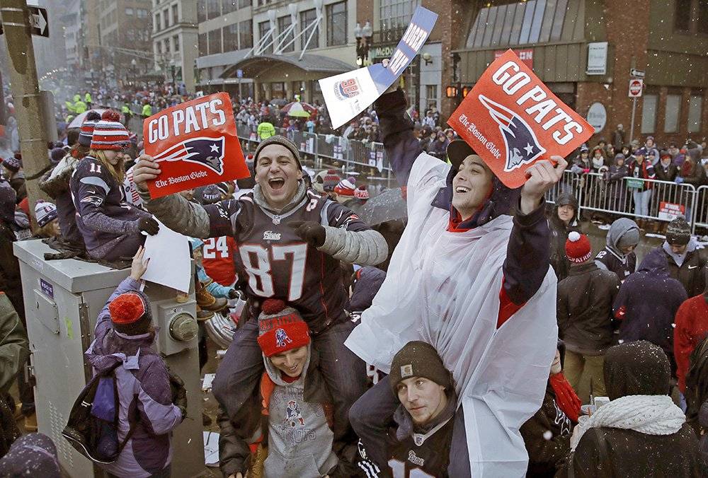 Patriots fans wait for the start of Tuesday's parade in Boston to celebrate their team's win in Super Bowl LI. If the mayors of Portland, Bangor and Brewer have their way, fans will get to celebrate with their team in Maine.