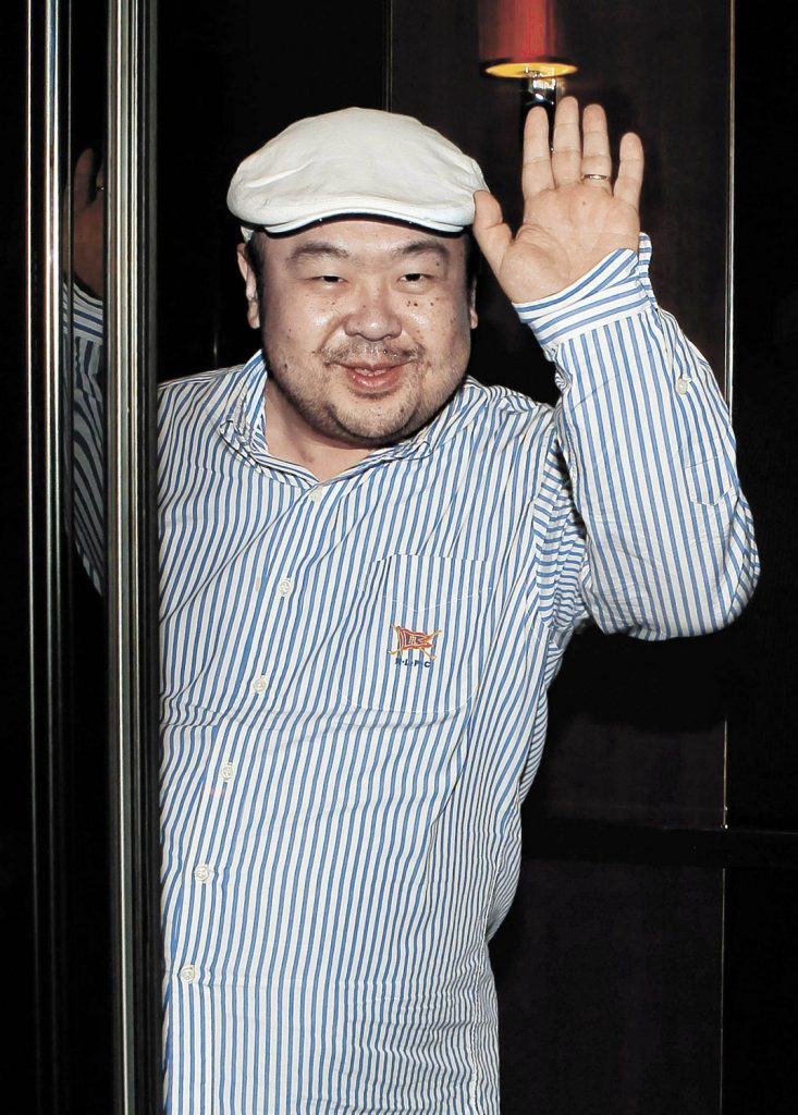 Kim Jong Nam, the eldest son of then-North Korean leader Kim Jong Il, waves after his first-ever interview with South Korean media in Macau on June 4, 2010.