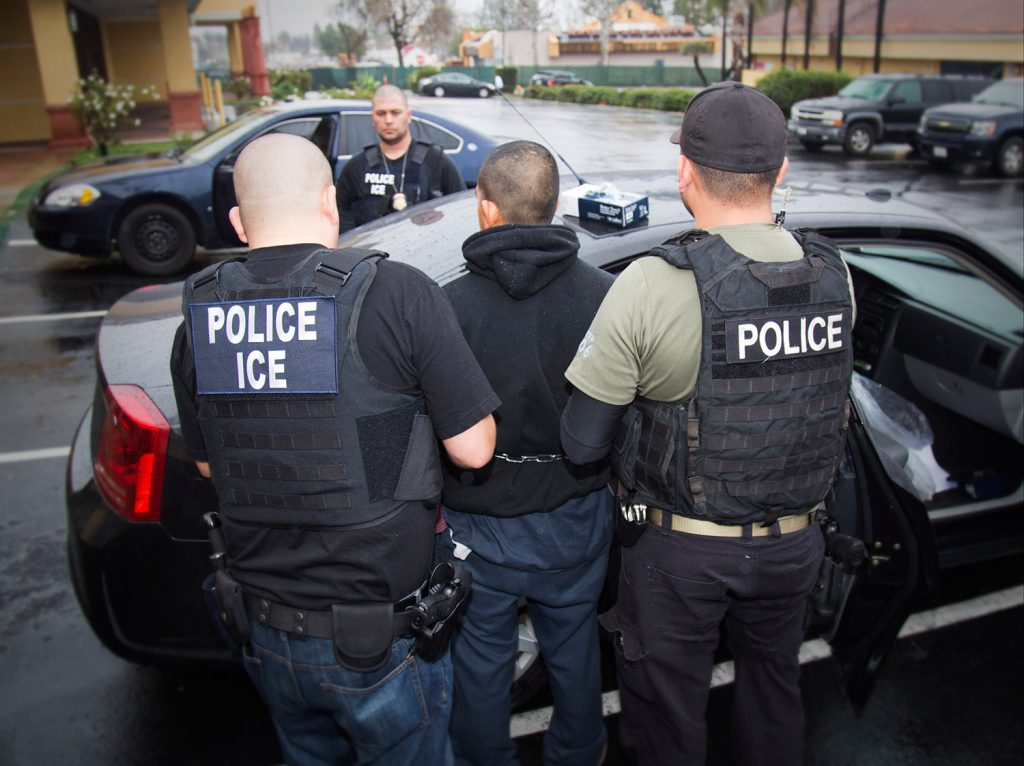 This photo taken Feb. 7, 2017, released by U.S. Immigration and Customs Enforcement, shows an arrest being made during a targeted enforcement operation conducted by U.S. Immigration and Customs Enforcement (ICE).
