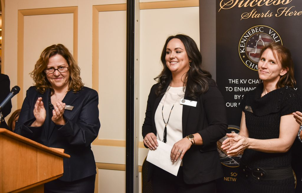 Stacey Morrison, left, Kennebec Valley Chamber of Commerce board chair, announces the appointment of Katie Doherty, center, as the next president and chief executive officer of the chamber at the Senator Inn in Augusta Wednesday night. Doherty then announced the promotion of Patty Hewitt, right, to the position of the chief operating officer. Morrison noted that Doherty is the first woman to hold the post.