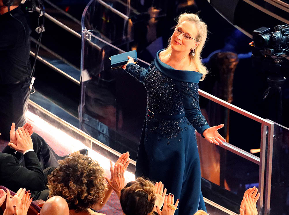 Actress Meryl Streep vamps a bit for an appreciative audience.