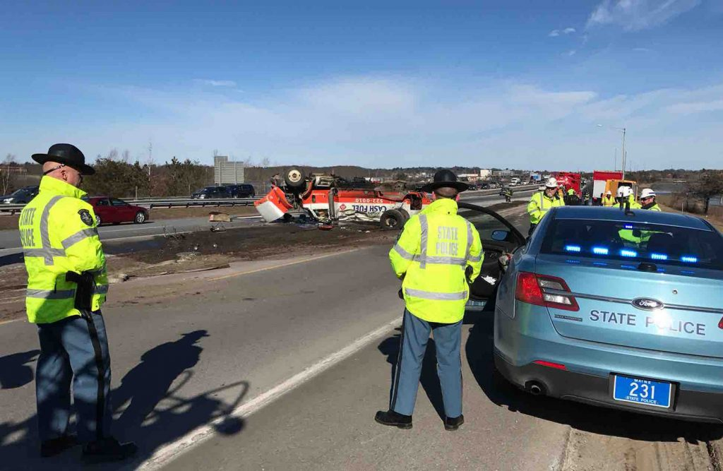 State police work at the scene of Monday's truck crash on Interstate 295.