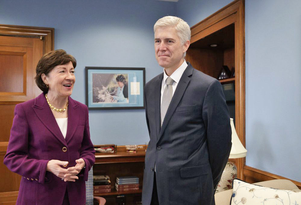 Supreme Court Justice nominee Neil Gorsuch meets with Senate Judiciary Committee member Sen. Susan Collins, R-Maine, on Capitol Hill in Washington on Thursday. The committee will oversee Gorsuch's confirmation hearing.