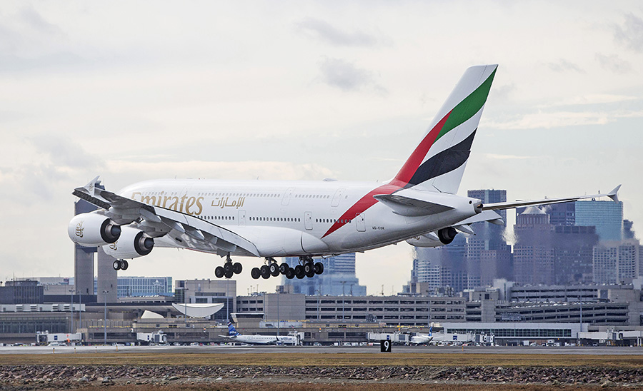 An Emirates plane lands at Logan International Airport in Boston on Jan. 26, 2017. Flight time from Dubai to Boston is about 14 hours, 15 minutes. Emirates' latest route from Dubai to Auckland clocks in at a whopping 16.5 hours – the lengthiest flight currently on the market.