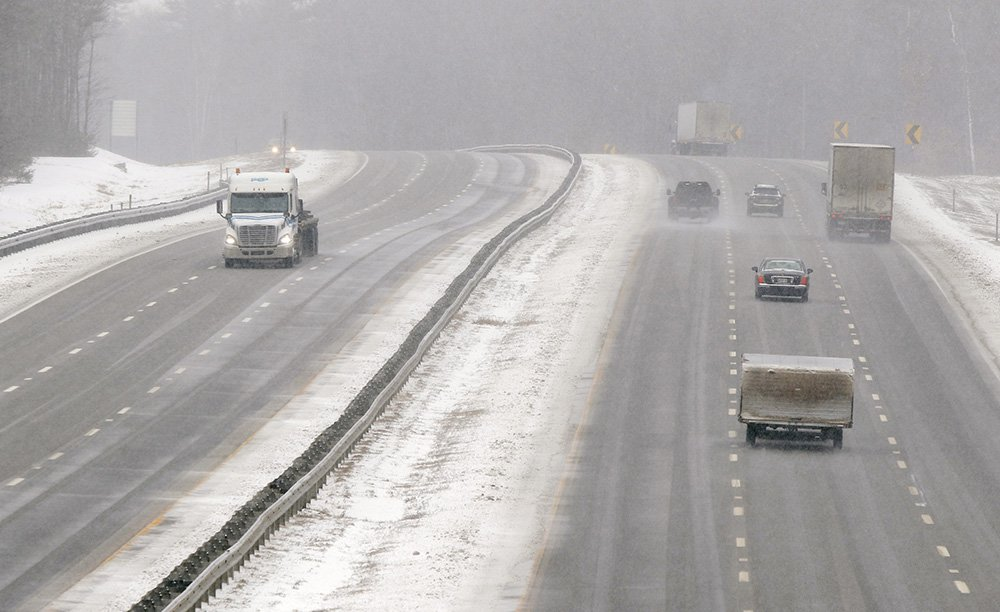 Motorists make their way along the Maine Turnpike in Arundel on Tuesday. Snow was expected to continue all day and turn into a wintry mix tonight.