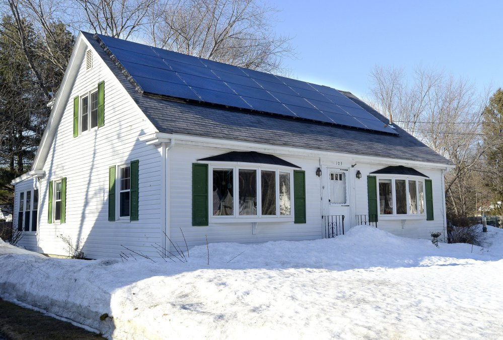 New solar power rules scheduled to go into effect in 2018 would scale back the energy credits received by homeowners who already have panels after 15 years, possibly including this home at 103 Wolcott St. in Portland.