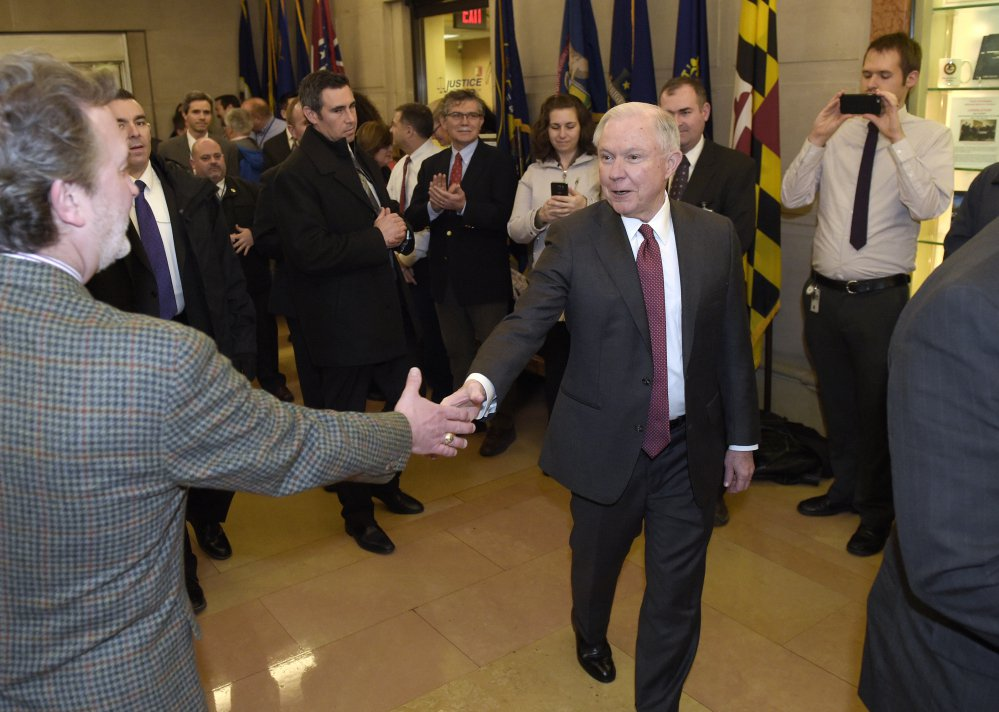 Attorney General Jeff Sessions is greeted by employees as he arrives at the Justice Department in Washington on Feb. 9. At his confirmation in January, Sessions didn't disclose that he had met twice with a Russian diplomat before the 2016 election.