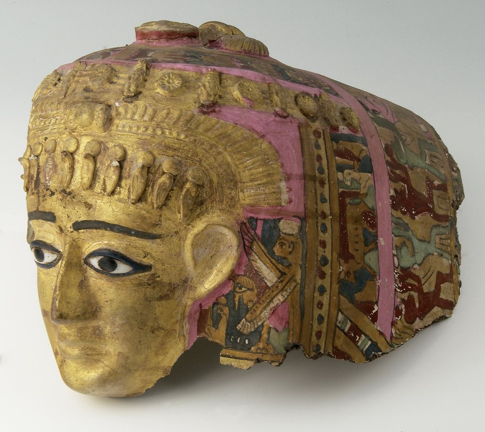 Mummy mask of a woman, Egyptian (Roman), ca. 1st century B.C.–1st century A.D., cartonnage with gold leaf, paint, agate eyes.