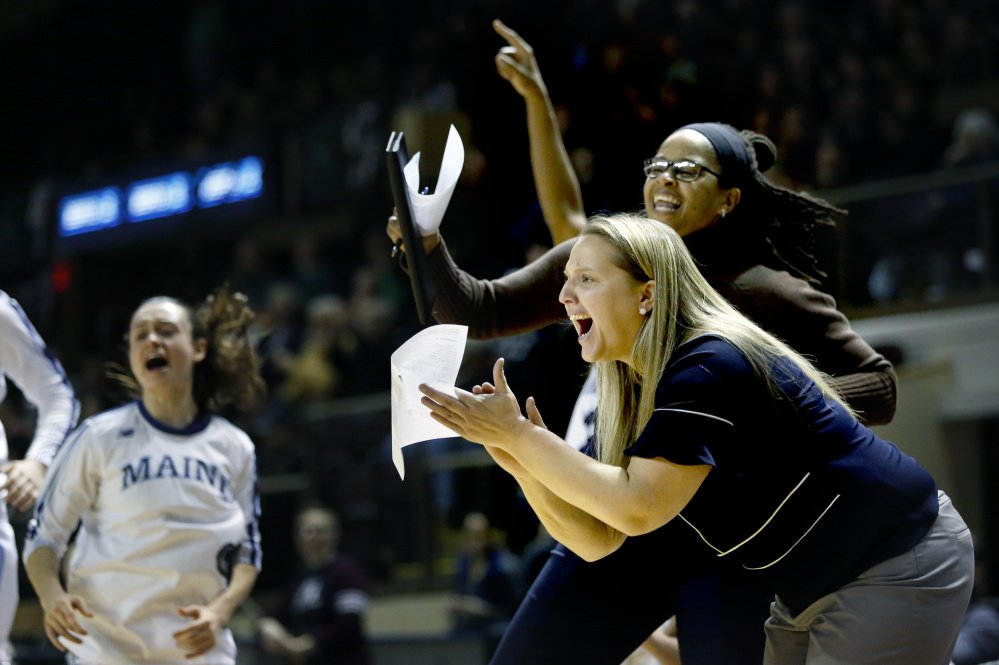 For players, some expressions aren't lost in translation. Coaches Amy Vachon, foreground, and Jasmine Player, cheer as the Black Bears increase their lead over Binghamton on Saturday. UMaine went on to win, 57-40.