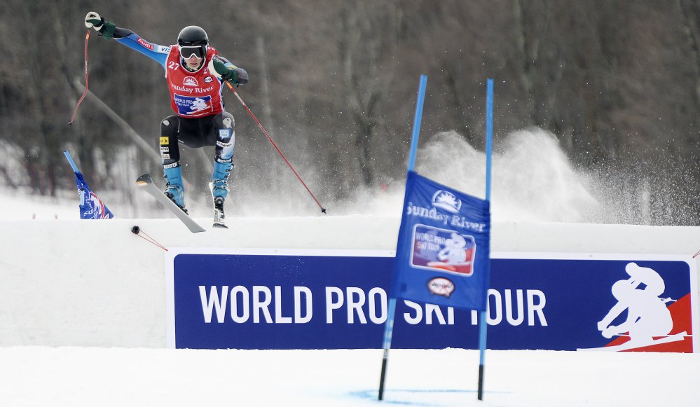 Henry Townsend of Winthrop takes a jump while going down the course during the World Ski Tour at Sunday River on Friday. The format has skiers racing side-by-side over jumps and around tight gates. One attraction is amateur skiers receive the opportunity to compete against professionals.