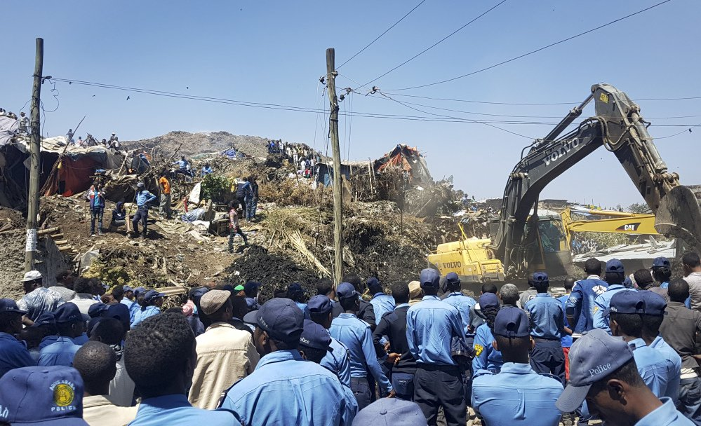 Police secure the perimeter at the scene of a garbage landslide, as excavators aid rescue efforts, on the outskirts of the capital, Addis Ababa, Ethiopia, on Sunday.