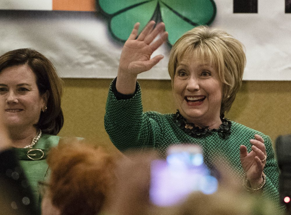 Hillary Clinton waves as she arrives at a St. Patrick's Day in her late father's hometown in Scranton, Pa., on Friday. Clinton said she was having a hard time watching the news.