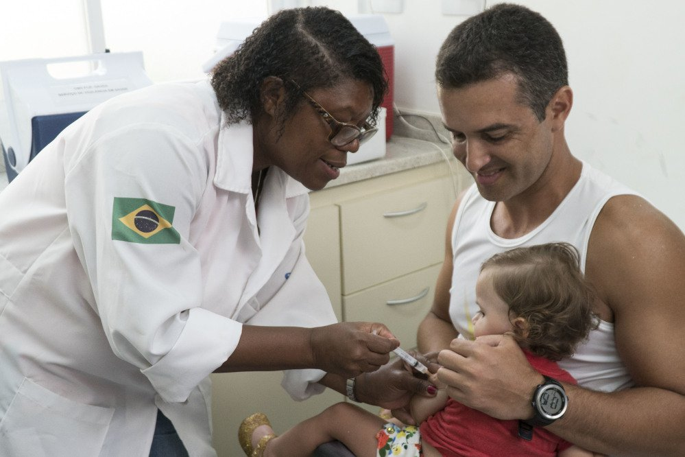 A nurse vaccinates a toddler against yellow fever at clinic in Rio de Janeiro, Brazil. Rio's health department says it has confirmed a fatal case of yellow fever.