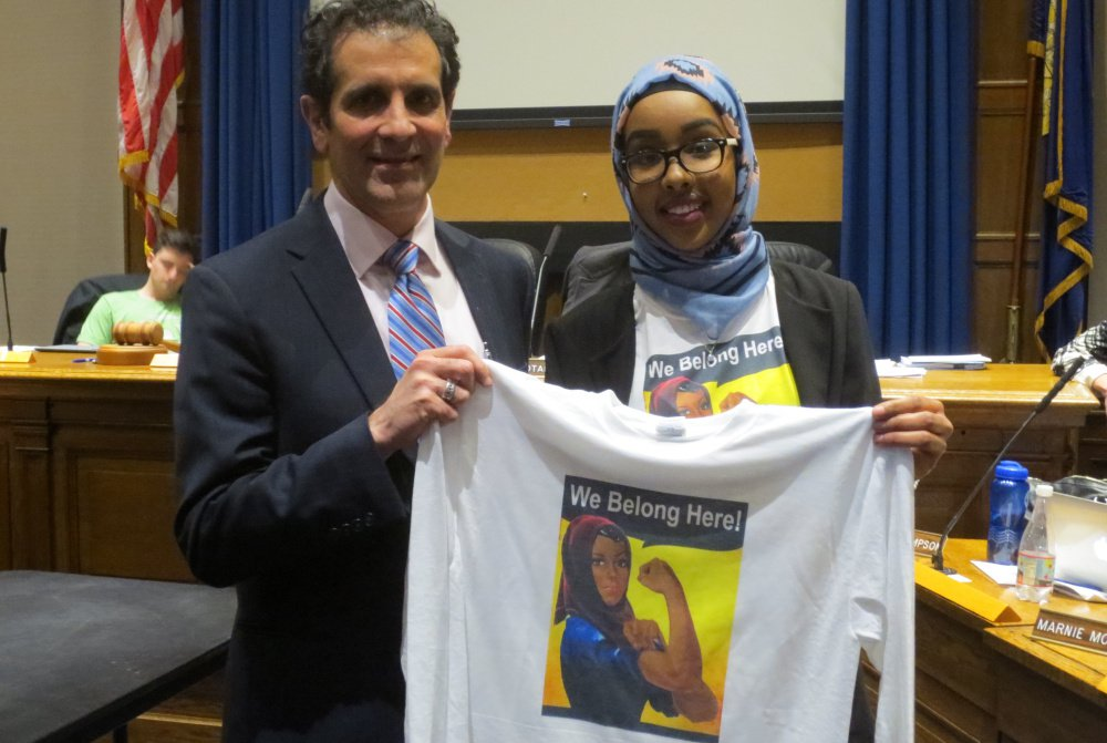 Superintendent Xavier Botana and Portland High School senior Zahra Abukar hold up one of the new Rosie the Riveter-style T-shirts.