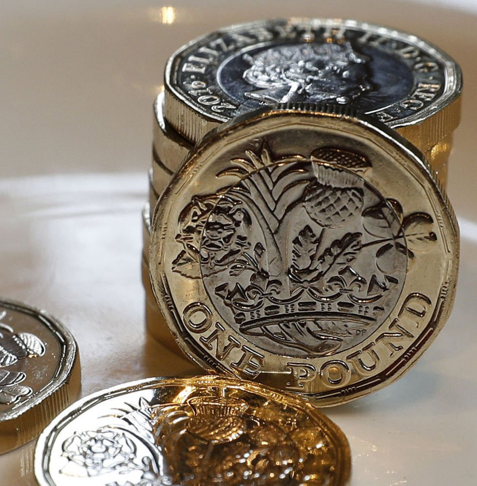 Britain's new 12-sided pound coin is intended to be hard to counterfeit and works just fine in vending machines.