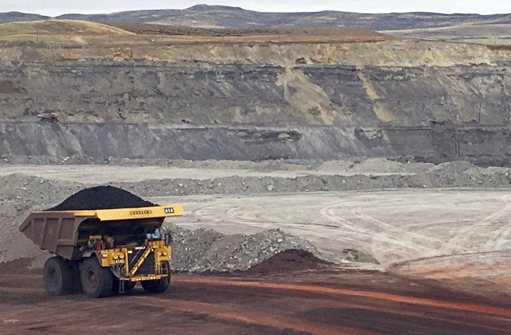 A truck hauls away a load of coal Tuesday at Contura Energy's Eagle Butte Mine near Gillette, Wyo.