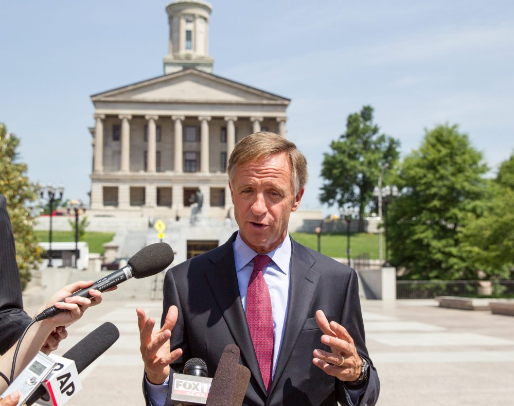 Gov. Bill Haslam speaks with reporters, in Nashville, Tenn., in 2014.