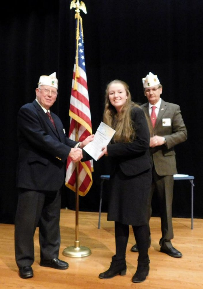 State Commaner Peter Johnson, left, awards Marina Long with a check in the amount of $1,500, a medal and certificate of achievement for her accomplishment. State Adjutant Paul L'Heureux, at right.