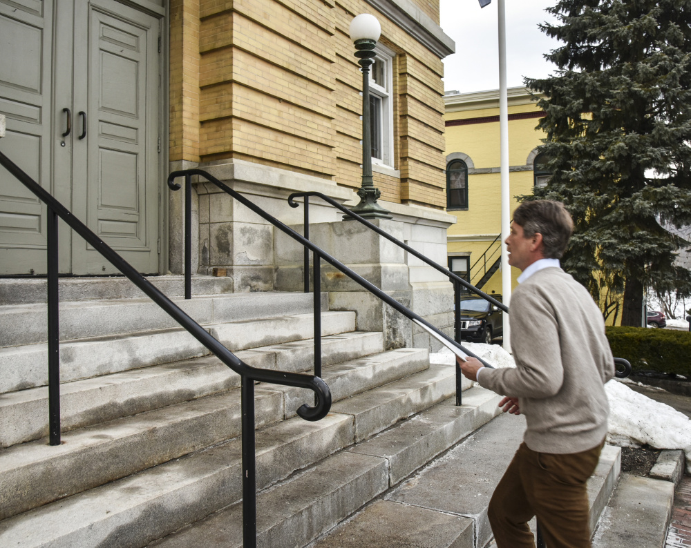 Stephen Langsdorf walks up the steps Feb. 24 at Hallowell City Hall to turn in a petition he's been circulating to require the City Council to reconsider its decision on a new fire station. He was required to get at least 216 signatures and turned in 288.