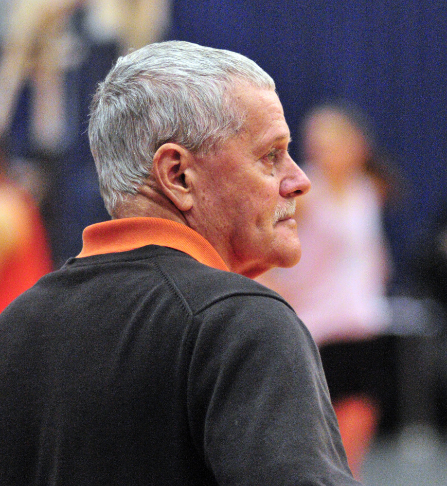 Brunswick volunteer coach Conrad Lewis watches as the team practices Thursday at the Augusta Civic Center.