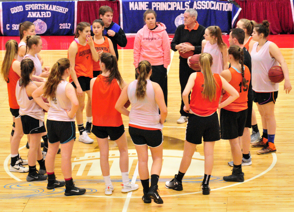 The Brunswick Dragons talk at midcourt during practice Thursday at the Augusta Civic Center.
