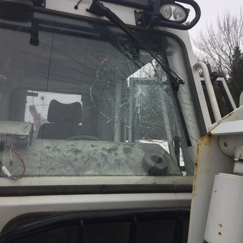 A Clinton Police Department photo shows vandalism reported to Central Maine Power Co. trucks that were parked off Route 23 near power lines.