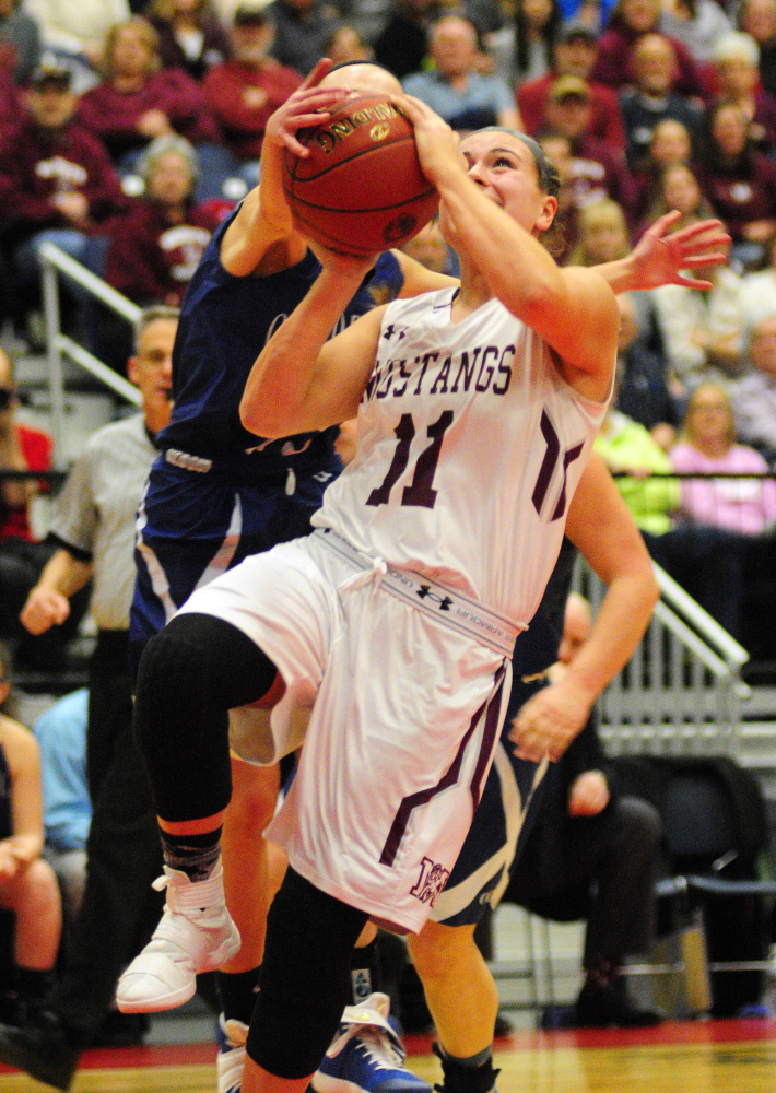 Old Orchard's Brianna Plante, left, blocks Monmouth's Hannah Anderson during the Class C South championship game last at the Augusta Civic Center.