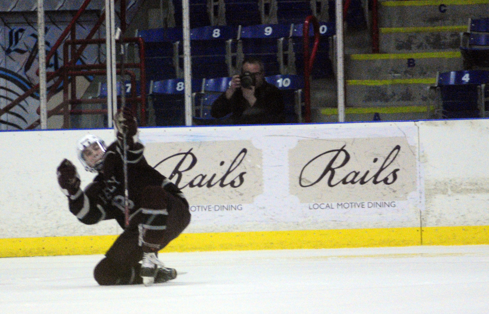 Greely's Jake MacDonald celebrates his first period goal against Gardiner in a Class B South semifinal game Friday night at the Androscoggin Bank Colisée in Lewiston.