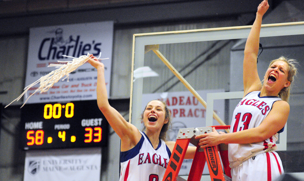 Messalonskee's Sophie Holmes, left, and Lydia Dexter celebrate after cutting down nets after defeating Brunswick in the Class A state final Saturday at the Augusta Civic Center.