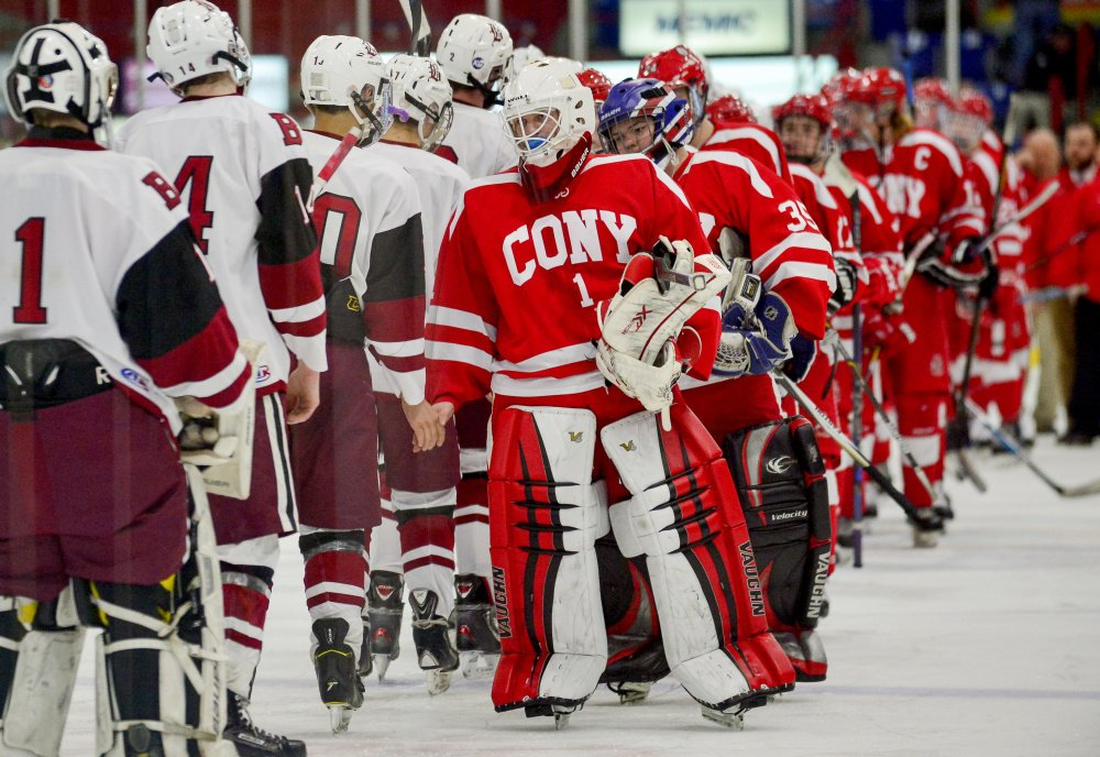 Cony goalie Dalton Bowie leads his team to congratulate Bangor in their 2-1 win in the Class A North semifinals Saturday in Lewiston.