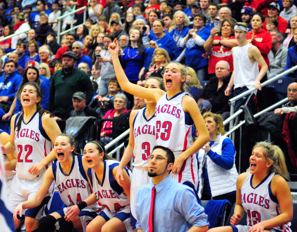 Messalonskee's bench and fans celebrate just before the clock runs out in the Class A state final Saturday at the Augusta Civic Center. The Eagles beat Brunswick.