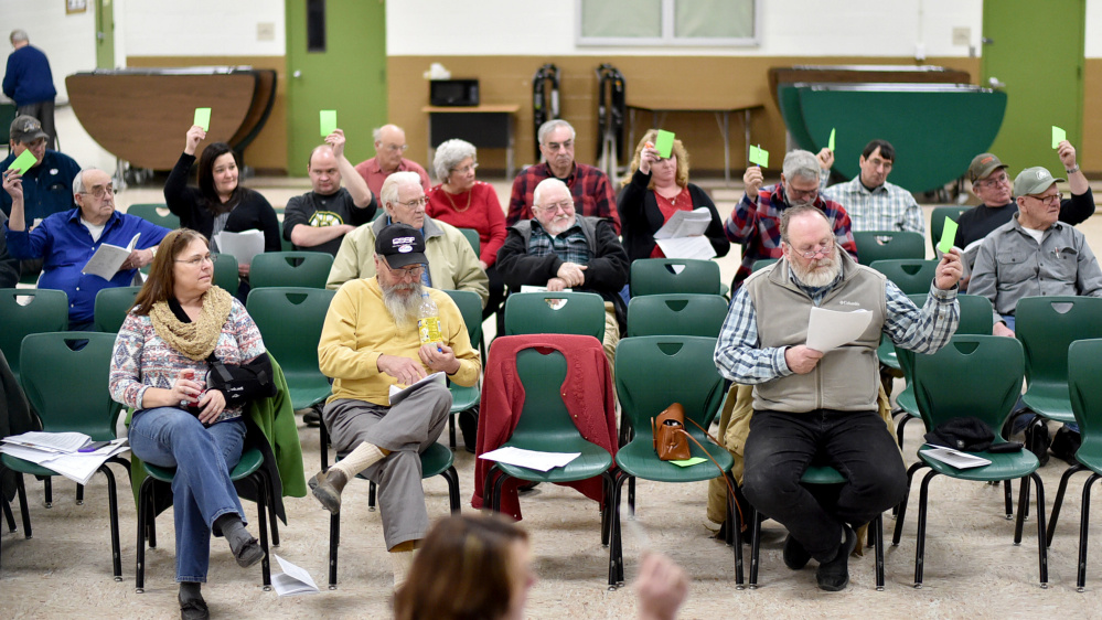 Anson residents vote down two articles Saturday during Town Meeting at Carrabec High School in Anson.