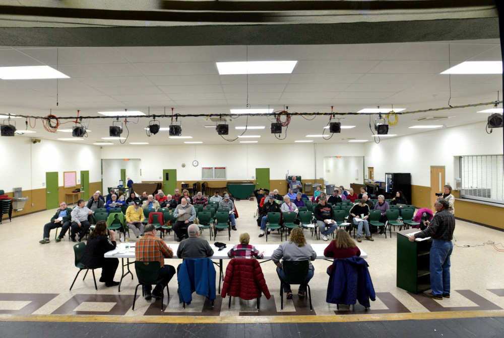 Anson residents gather on Saturday at Carrabec High School to vote on articles during Town Meeting in Anson.