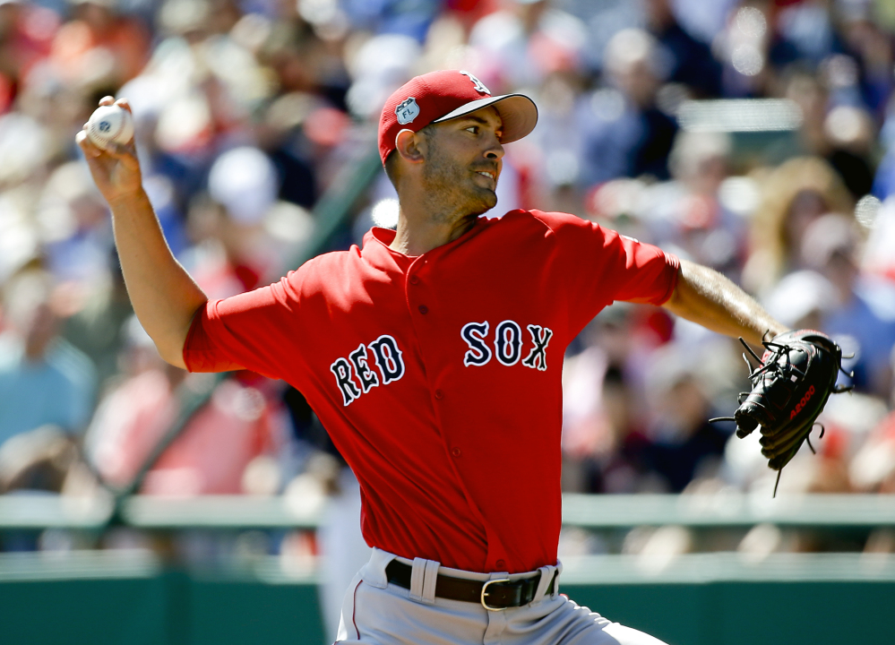Boston Red Sox starting pitcher Rick Porcello throws against the Atlanta Braves in the first inning of a spring training game last Friday.