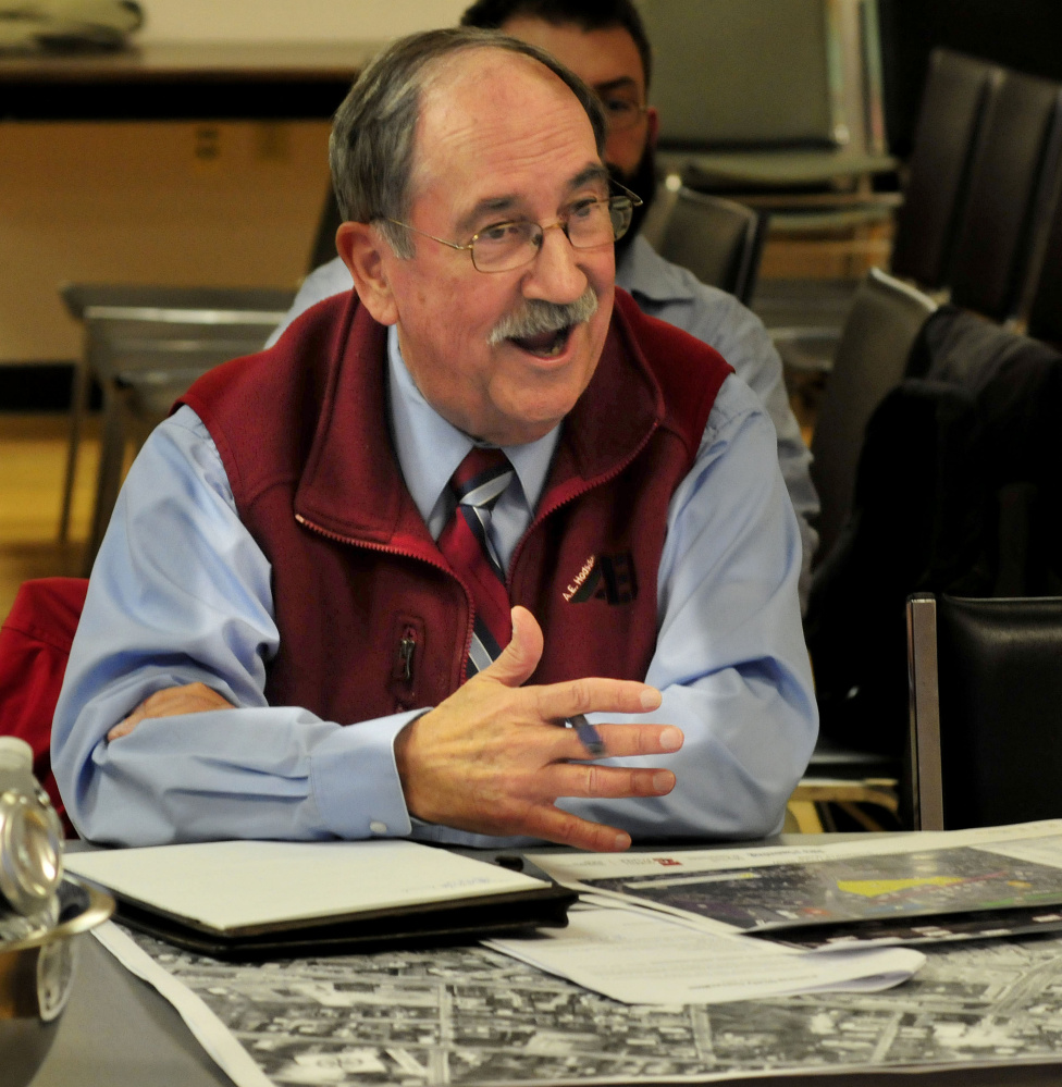 Al Hodsdon, owner oif A.E. Hodsdon Engineers, sits beside maps and photos of Waterville while speaking Wednesday evening to other members of the Waterville Parking Study Committee during its inaugural meeting.