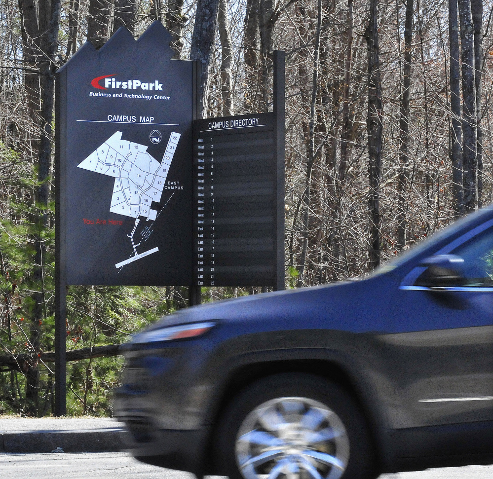 A driver passes a FirstPark directory sign on April 14, 2016, at the business facility in Oakland.