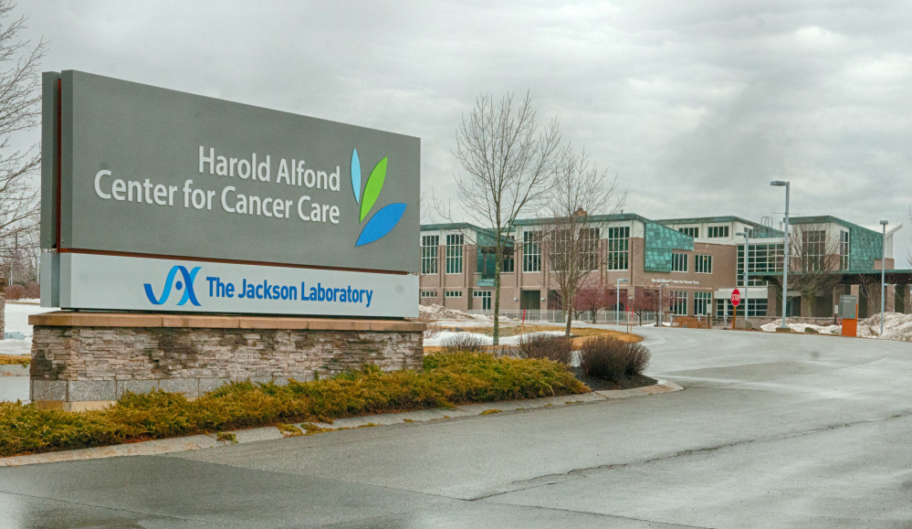 The Jackson Laboratory's name has been added to the sign, seen Wednesday, at the Harold Alfond Center for Cancer Care in Augusta.
