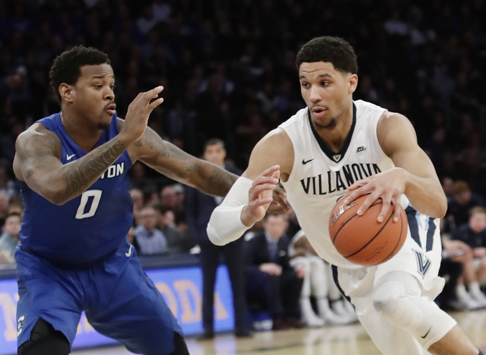 Villanova's Josh Hart (3) drives past Creighton's Marcus Foster (0) during the first half of the Big East championship game Saturday in New York.