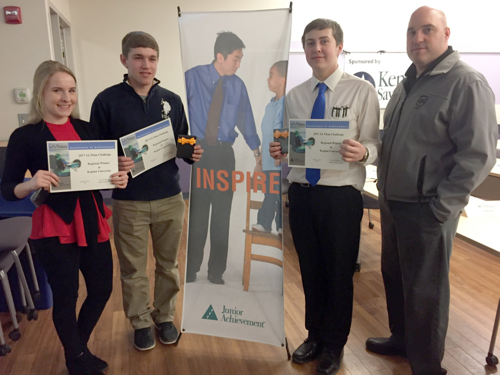 Contributed photo   Erskine Students, from left, Courtney Austin, Billy Howell and Marc Walther, with their mentor Jeff Wilson from UPs, won the regional Titan Challenge held at Kaplan College.