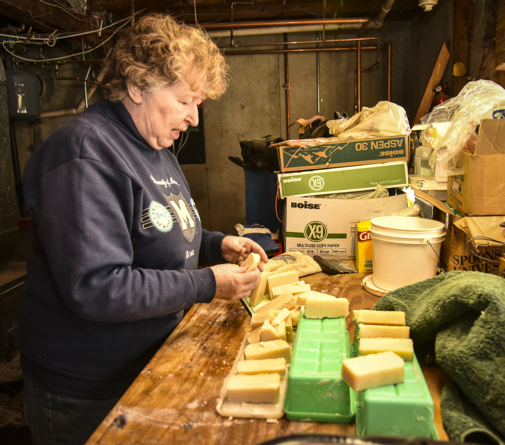 For Elaine Briggs, of Wayne, aging in place means continuing to do the hobbies and crafts she enjoys doing in her own home. She is shown Sunday with her with spearmint- and lavender-infused soap that she made in the basement of her home.
