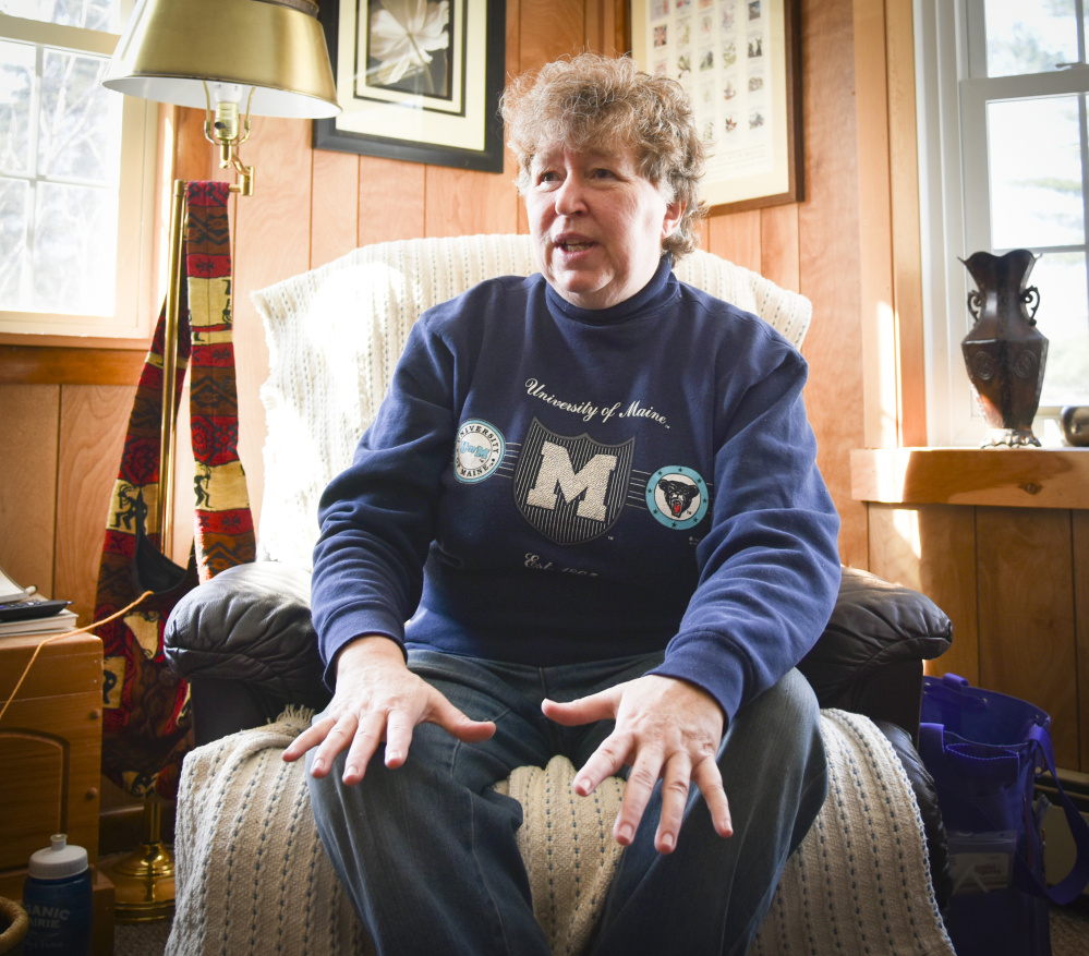 Elaine Briggs, of Wayne, seen Sunday at her home, shows off one of the many items she has knitted. While she is still working, she hopes to retire and stay in her home in Wayne. A prolific knitter, she knits a variety of items for family and friends, as well as local charities.
