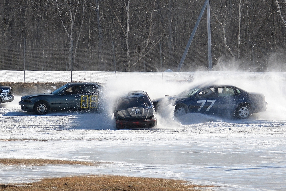 Several cars kick up some snow during the Snowbowl Enduro 100 at Unity Raceway on March 5.