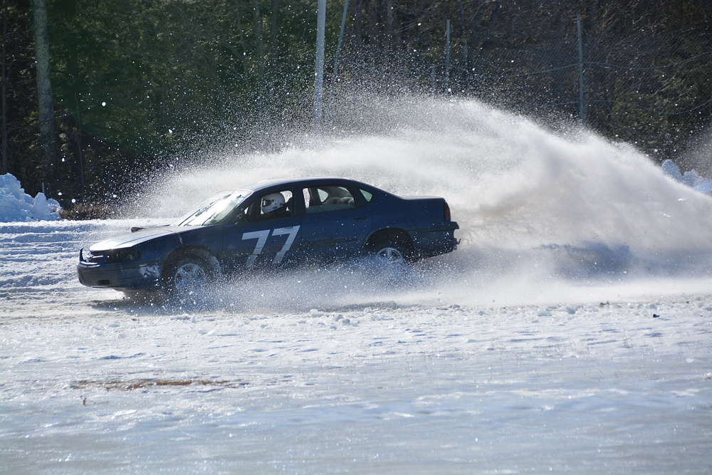A car blasts its way through some snow during the Snowbowl Enduro 100 at Unity Raceway on March 5