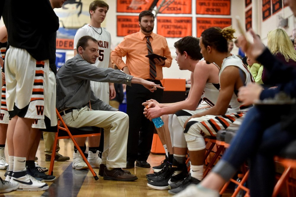 Winslow boys basketball coach Jared Browne talks to his team in a timeout during a Kennebec Valley Athletic Conference game against Erskine this past season.